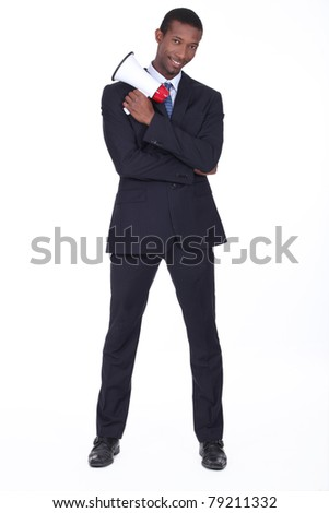 Man in suit holding megaphone - stock photo