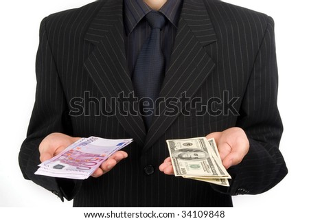 man in suit holding money - stock photo