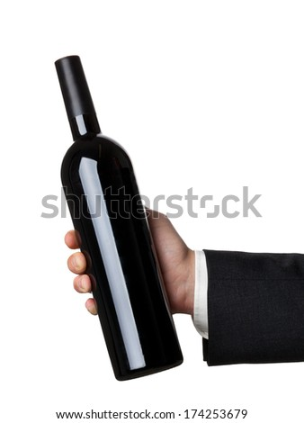 Man in suit holding red wine bottle isolated on white background - stock photo