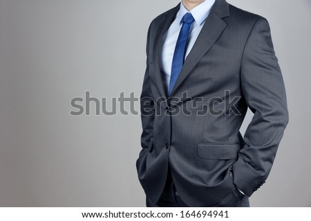 Man in suit in gray background - stock photo