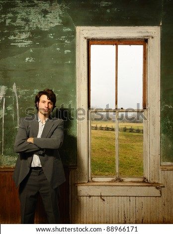 man in suit in interior of an abandoned home