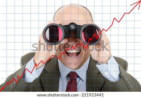 Man in suit looking at future growth of sock profit through binoculars - stock photo