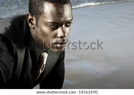 man in suit on the ocean - stock photo