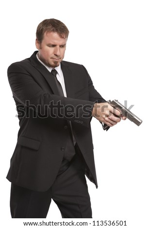 Man in suit points his weapon - stock photo