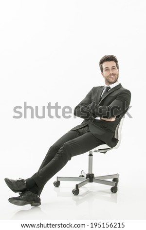 man in suit sitting on a chair  on isolated background - stock photo
