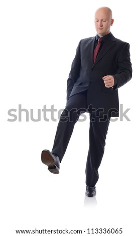 Man in suit stepping on something isolated on white