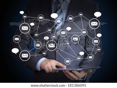 Man in suit, tablet pc and contacts. The concept of global contacts