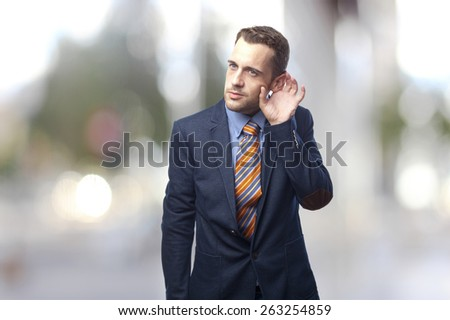 Man in suit trying to listen - stock photo
