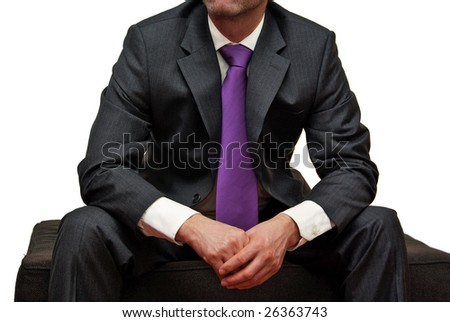 Man in suit wearing purple tie, isolated on white background - stock photo