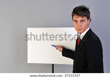 man in suit, white empty presentation board - stock photo