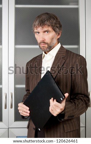 man in suit with business papers in folder