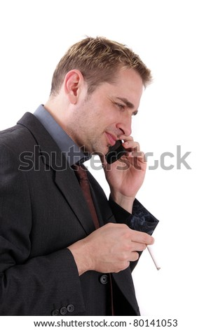 Man in suit with cigarette and mobile phone