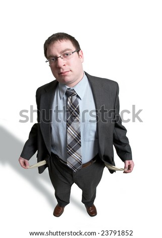 Man in suit with empty pockets isolated on white - stock photo