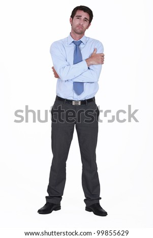 Man in suit with expression of sadness - stock photo