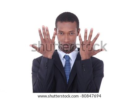 Man in suit with hands up by face - stock photo