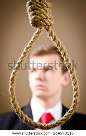 Man in suit with hanging noose - stock photo