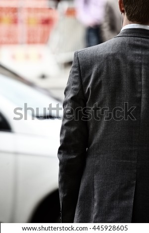 Man in suit with headphones on his way home from office