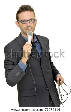 Man in suit with microphone - stock photo