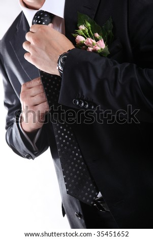 man in suit with necktie and flowers