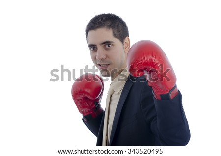 Man in suit with red boxing gloves over white background.