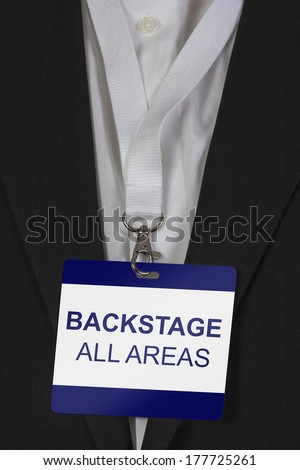 man in suite wearing a Backstage pass with the addition all areas arround his neck - stock photo