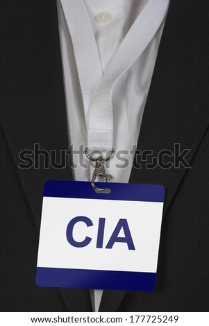man in suite wearing pass labeled CIA arround his neck - stock photo