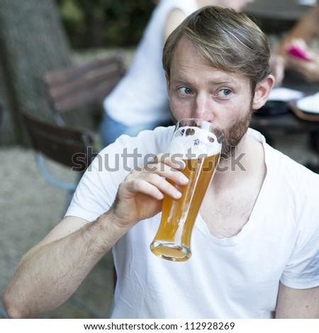 man in summer garden - stock photo