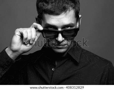 man in sunglasses. Brutal boy in sunglasses