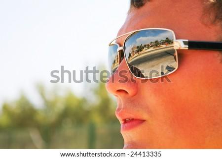 man in sunglasses. travel - stock photo