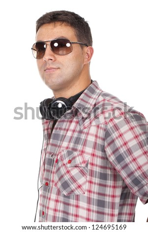 man in sunglasses with headphones around his neck - stock photo