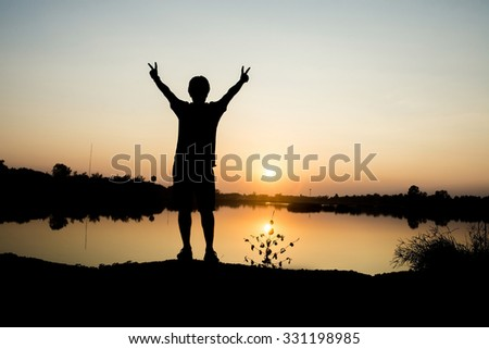 Man in sunset ,Gold light from sunset ,Freedom and happiness man in park