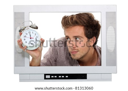 Man in television with alarm clock