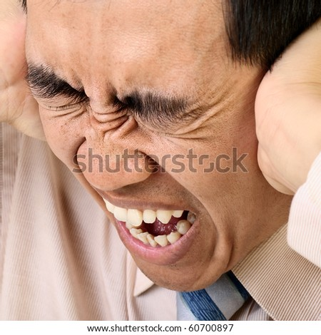 Man in tension, closeup portrait of Asian businessman. - stock photo