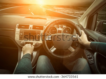 Man in the car - stock photo