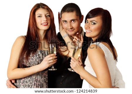 Man in the company of two women at a party - stock photo
