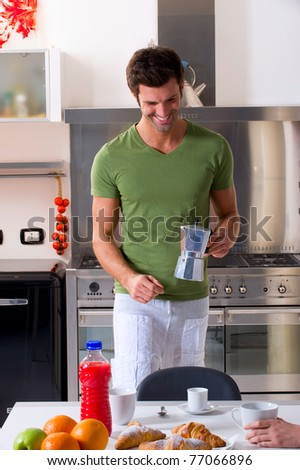 man in the kitchen preparing breakfast