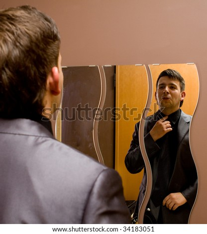 Man in the mirror at home - stock photo