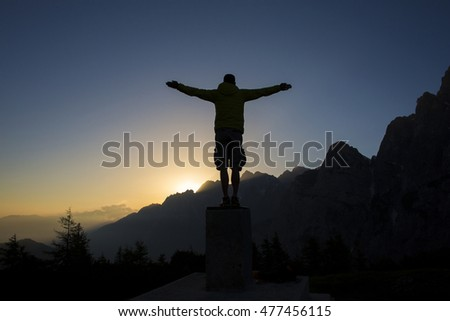 Man in the mountains at sunrise