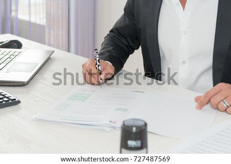 man in the office, man sighing papers,  man working in the office, working in the office,paper work, sighing the contract