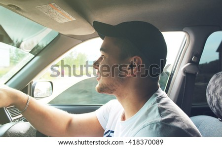 Man in the white shirt behind the wheel