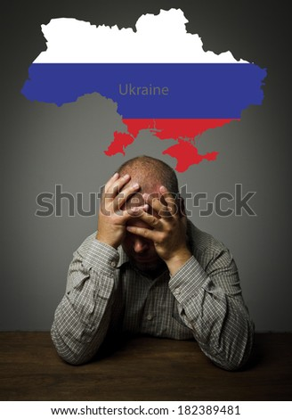 Man in thoughts about the future of Ukraine. Russian flag. - stock photo