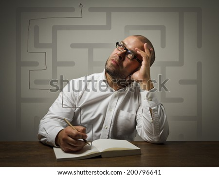 Man in thoughts. Maze concept. Man looking for the solution.  - stock photo