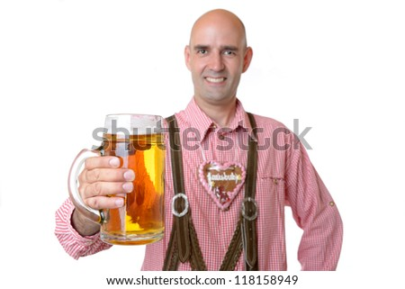 man in traditional bavarian garb with beer - stock photo