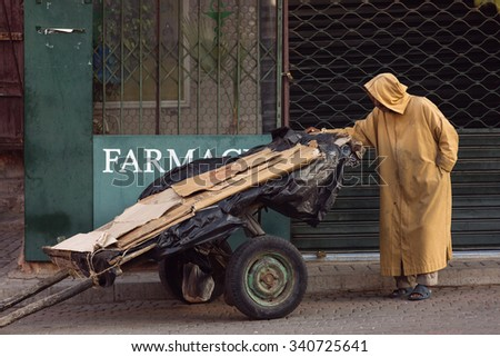 Man in traditional jilaba on the street of Marrakech, Morocco - stock photo