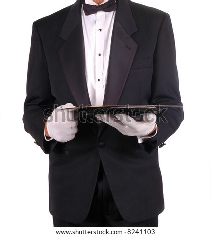 Man in Tuxedo Holding Serving Tray isolated over white - stock photo