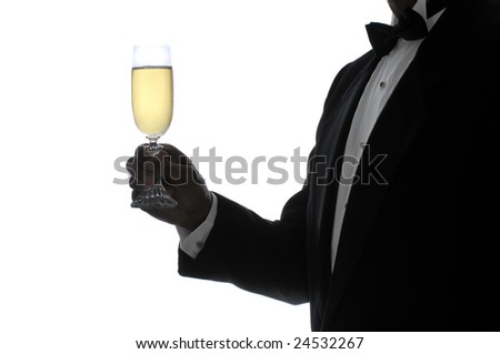 Man in Tuxedo in Silhouette Holding a Glass of Champagne - stock photo