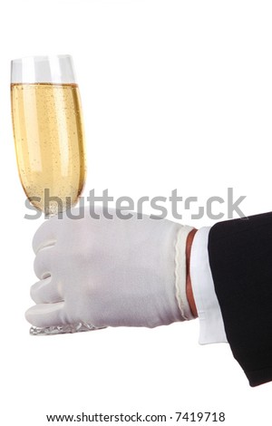 Man in Tuxedo Serving Champagne Glass isolated over white - stock photo