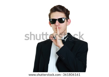 man in tuxedo sign for quiet or secret - stock photo