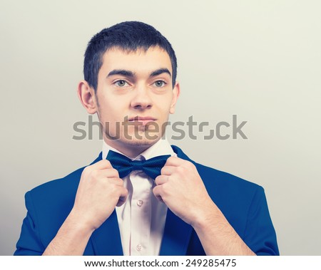 Man in tuxedo.Smoking - stock photo