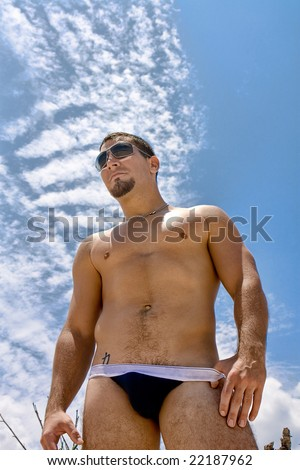Man in underwear oposite blue sky - stock photo